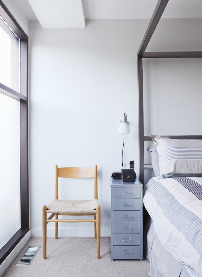 Bedroom, Bed, Night Stands, Chair, Table Lighting, Lamps, and Carpet Floor The master bedroom occupies a private space on the top floor.  Bedrooms by Dwell from Narrow Modernist Three-Story Home in Toronto