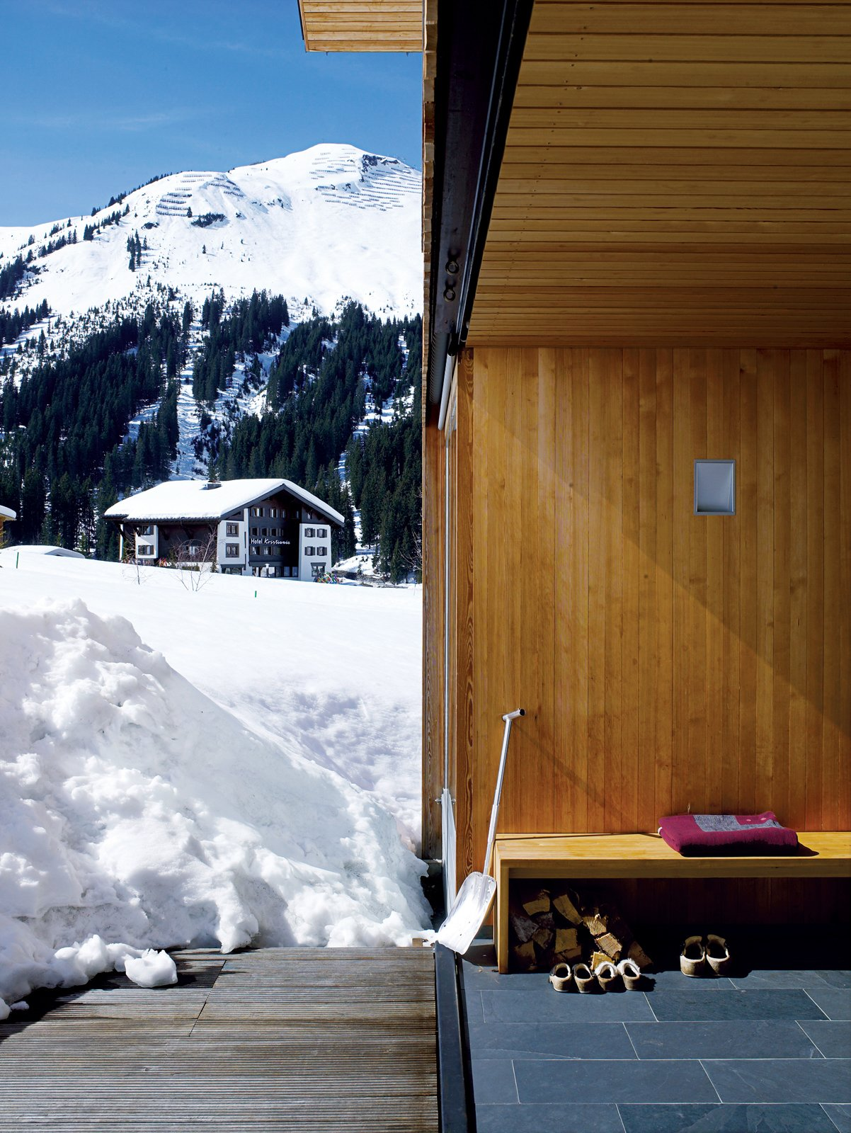 The porch also has its own protective wooden shutter, which rises upwards from a recessed pocket in the floor.  Photo 8 of 8 in Snow Proofed Hillside Family Home in Austria