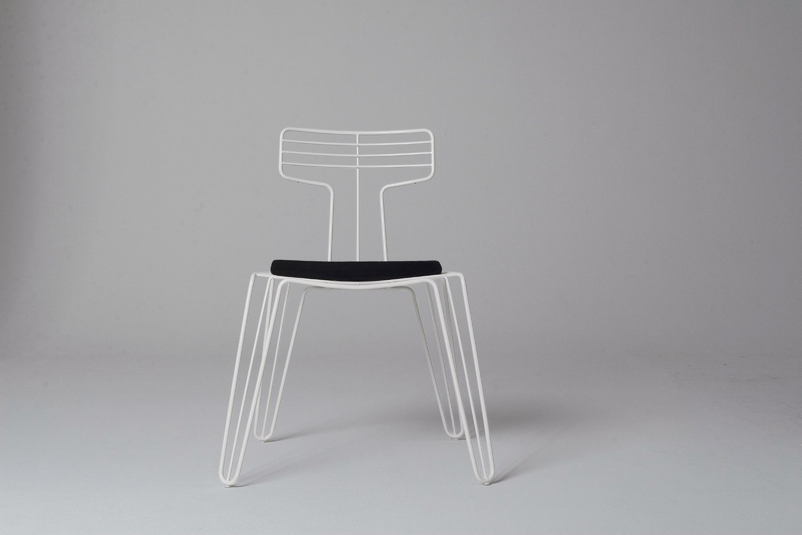 A dining chair from Tom Dixon's Wire series, which includes a coat rack and stand.  Photo 6 of 8 in Tom Dixon