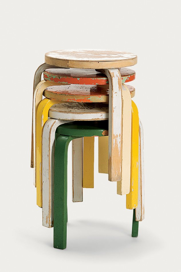 A stack of painted and worn Stool 60s, perhaps one of the most popular pieces from Artek's archive, given new life in the 2nd Cycle series.  Photo 8 of 8 in Tom Dixon