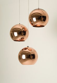 Tom Dixon's Copper Shade pendant lamps reflect his background in metalwork.