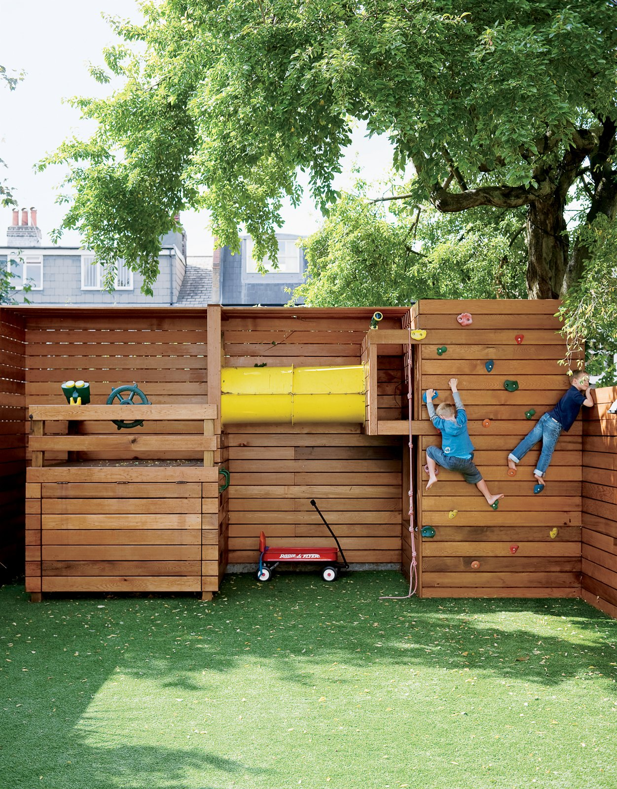 Outdoor If tidiness is paramount for the family, a place for the kids to play outdoors is equally important. The climbing wall at the back of the garden is entirely the work of Mark Tiarks, who built the Composite House and who relished a chance to step out from beneath Tozer's plans and design an aspect of the house himself.  Fun Custom-Built Children's Playsets by Zachary Edelson from Composite Index