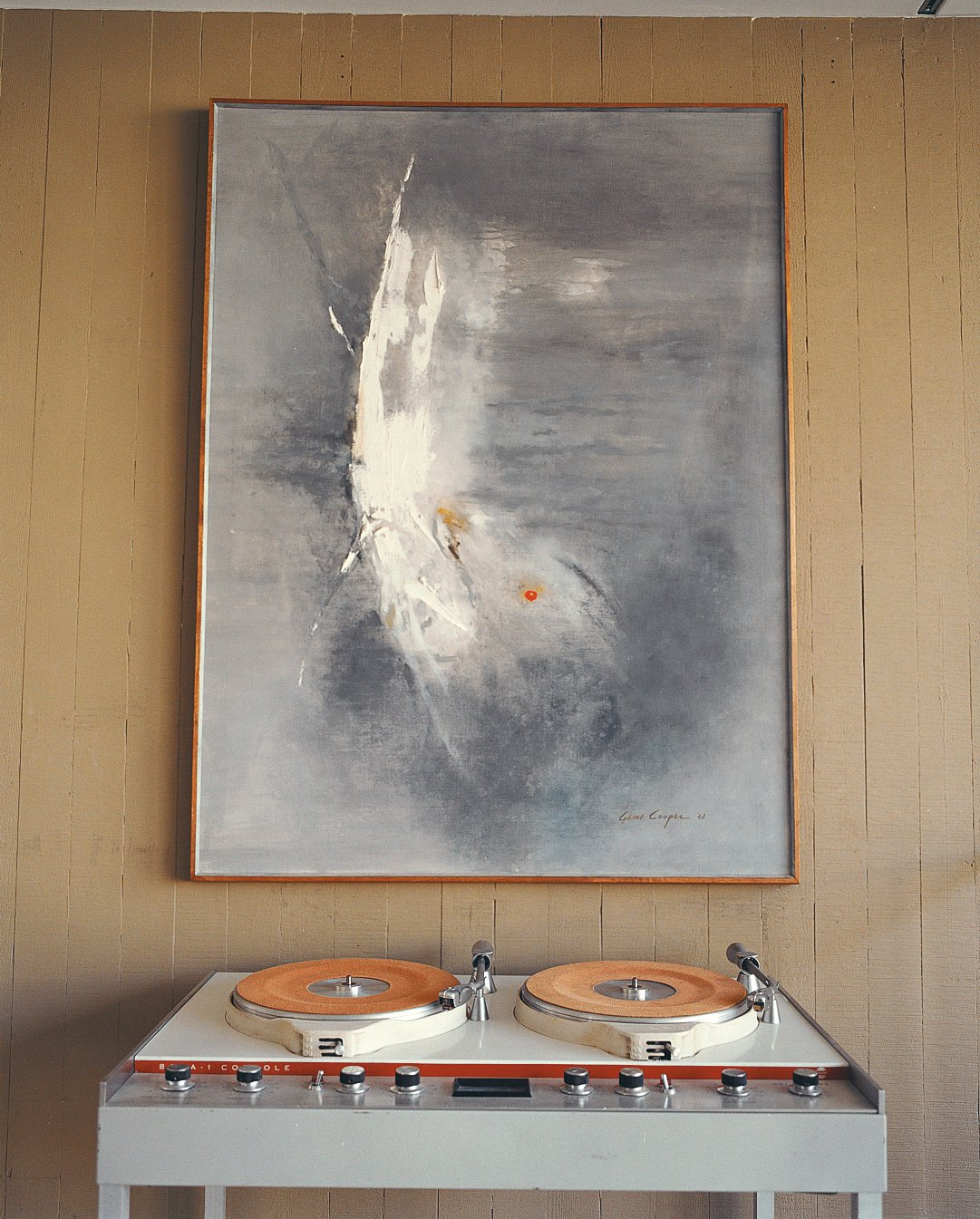 Living Room Stevens pared down his collection of vintage furniture and art considerably when he bought the Opdahl house, but he saved critical pieces such as this Gene Cooper painting.  Photo 8 of 10 in Opdahl Remastered