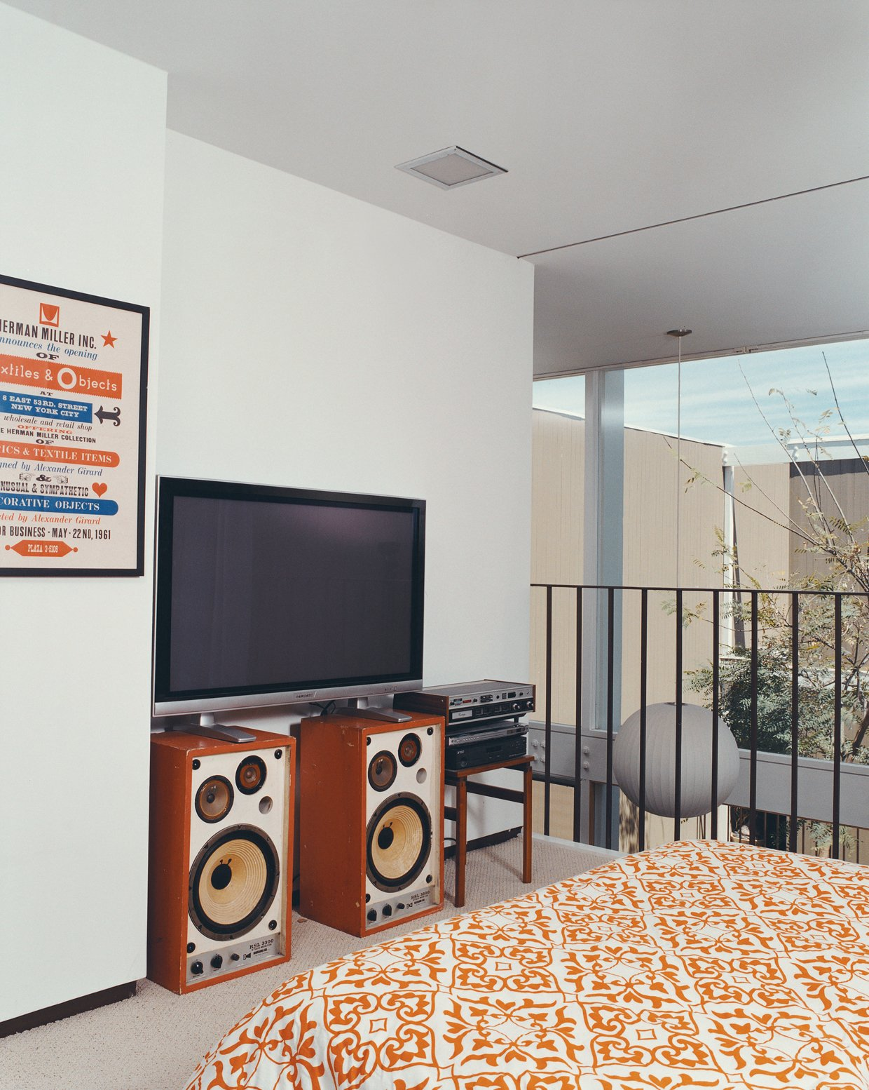 An Alexander Girard poster for the Herman Miller Textile & Objects Shop in the master bedroom is original to the house.  Photo 10 of 10 in Opdahl Remastered