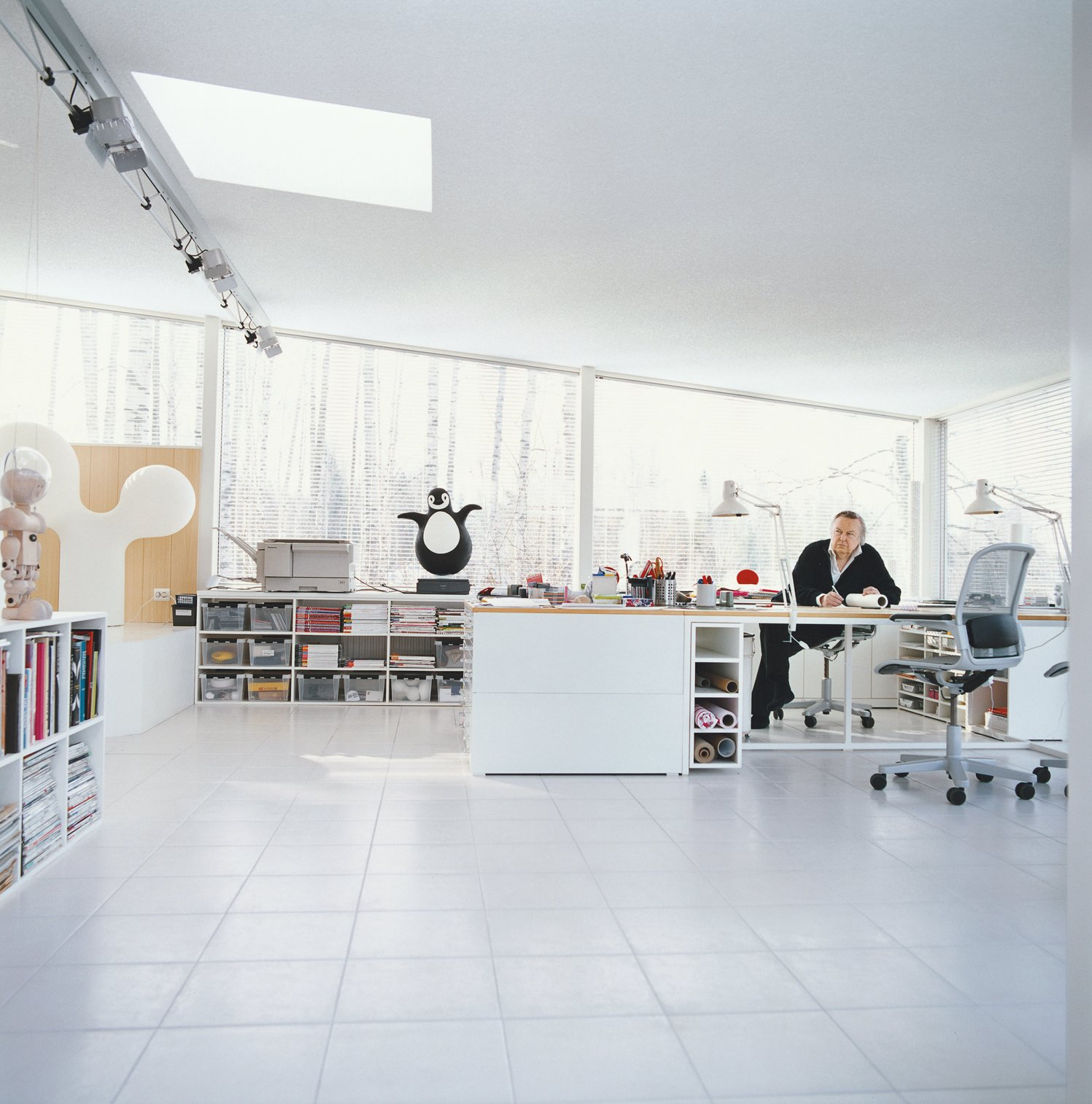Roll of tracing paper in hand, Aarnio contemplates his next move in his home office addition.  Photo 8 of 13 in Furniture Designer Focus: Eero Aarnio