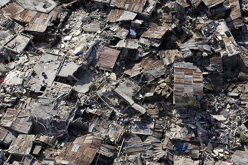 An aerial view of an impoverished neighbourhood in Port-au-Prince demonstrates the extent of damage inflicted by the powerful earthquake that rocked the Haitian capital on 12 January.  13/Jan/2010. Port-au-Prince, Haiti. UN Photo/Logan Abassi. www.un.org/av/photo/  Photo 1 of 1 in Rebuilding Haiti