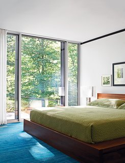 The master suite contains the only nonvintage furnishing: a BoConcept bed.