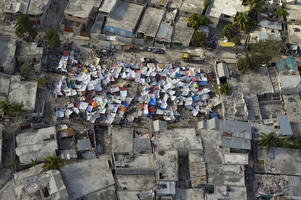 Haitians set up impromtu tent cities thorough the capital after an earthquake measuring 7 plus on the Richter scale rocked Port au Prince Haiti just before 5 pm yesterday, January 12, 2009. Image: UN Development Programme on Flickr  Photo 1 of 1 in An Architecture Prof Weighs in on Haiti