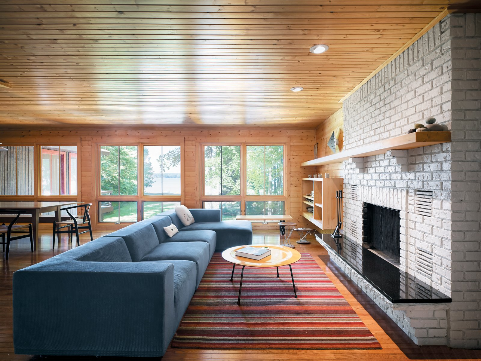 George Nelson and Eames furnishings from Michigan companies like Herman Miller blend seamlessly with original decor from Keith Campbell's childhood home in Ann Arbor. Seen here is the combined living and dining area.  Photo 3 of 12 in Campbells' Coup