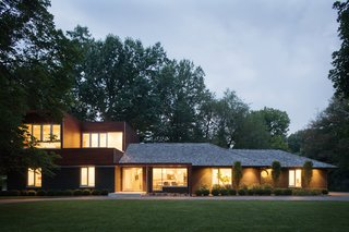 """Dubbed """"Modern with a Side of Ranch,"""" this house in Leawood, Kansas, marries a modern addition to an existing ranch style home."""