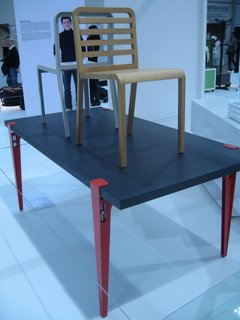 This piece, by Philippe Nigro for Ligne Roset, is called the Table Universelle. The adjustable legs, constructed of laser-cut and folded steel, are available in red, white or black lacquer, and can fit any tabletop.