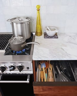Organization is key: Blum storage systems in the Henrybuilt drawers keep the whisks from ensnaring the spatulas.