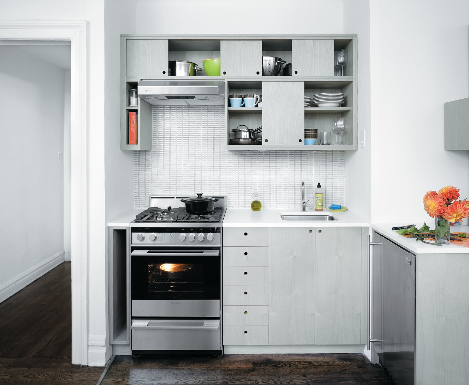 Choosing tile for the kitchen backsplash was the biggest struggle of the project, according to Brechbuehler. They settled on light gray horizontal bars by Ann Sacks.  Solutions For Tiny Kitchens by Aileen Kwun from A Clean Slate