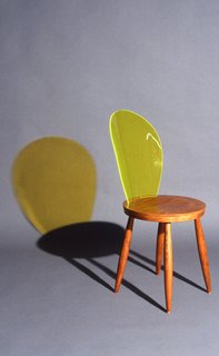 """An homage to the medallion Louis XVI chair, Delo Lindo's 1992 """"Butterfly"""" chair merges traditional wood with fluorescent green translucid methacrylate. © D. Feintrenie"""