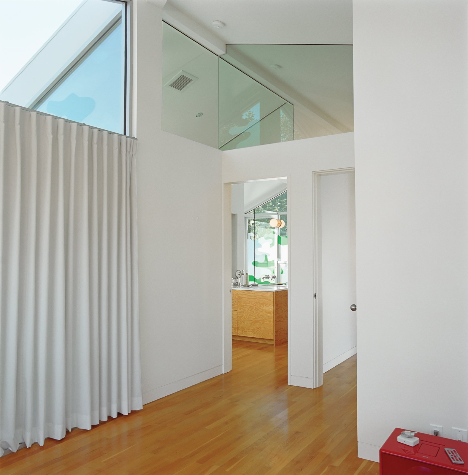 Bestor restricted the height of the walls on the second floor to allow the clerestory windows to carry light from the front deck all the way to the guest bedroom in back.  Photo 13 of 13 in 5 Architectural Tricks and Devices to Bring Natural Light Into Your Home