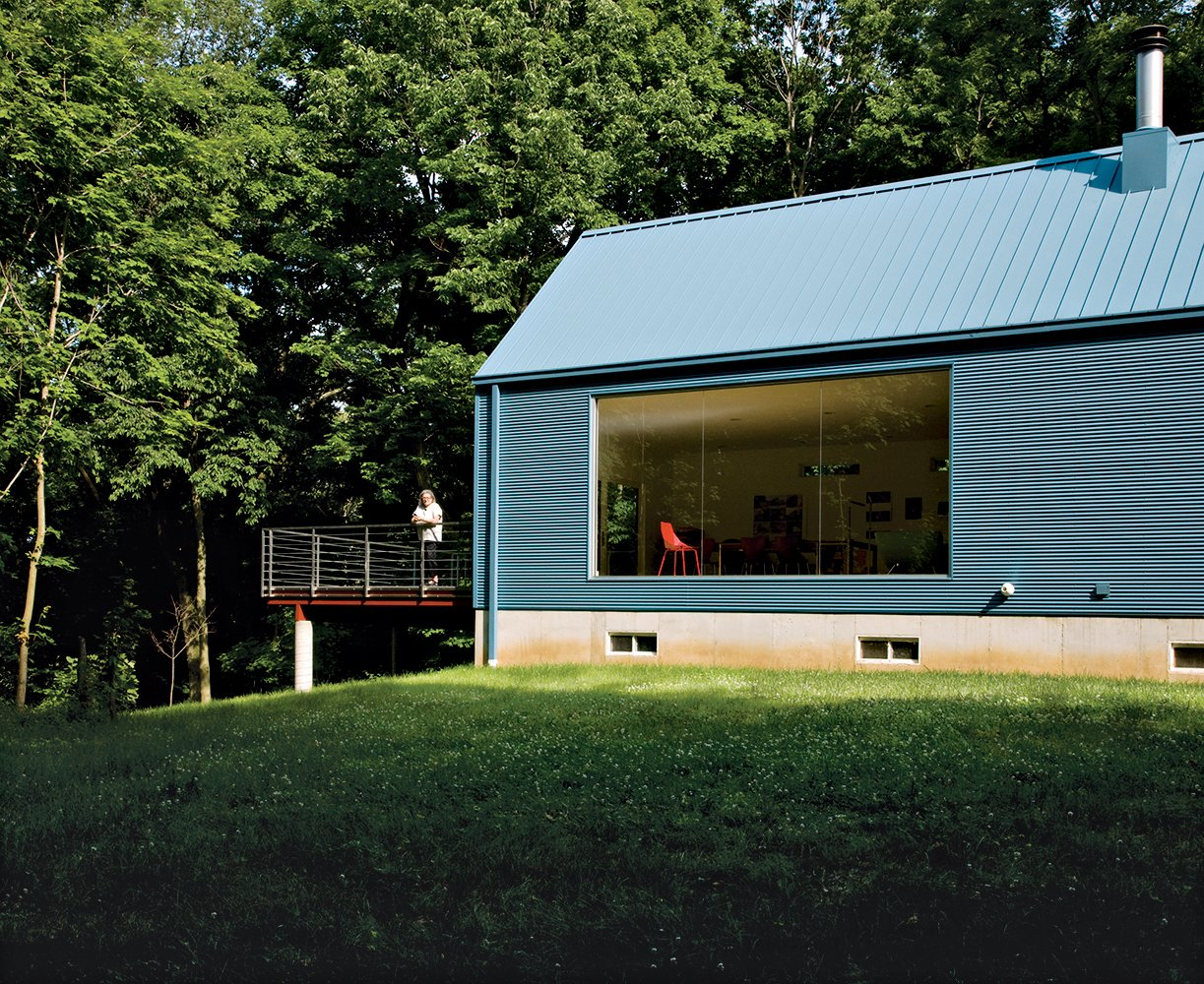 Exterior, House Building Type, Metal Roof Material, and Metal Siding Material The floor-to-ceiling living-room window was inspired by Philip Johnson's Glass House.  Photo 6 of 10 in Bringing It All Back Home