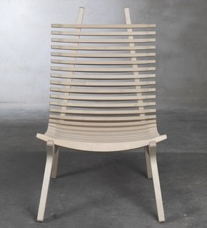 The IBBI lounge chair by designer Nils Gulinis features two distinct parts— Mirror-image frame supports, which give the chair shape, and 29 sculpted laths that cradle the body, providing the chair with beautiful lines from every perspective. IBBI also has a thin seat pad for comfort, and a headrest available.