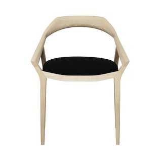 Swedese's second chair to make the list is by Swedish designer Monica Förster, who has clearly been very busy, with many new pieces on display at the stands of different furniture and lamp makers this year. The Antelope chair was a favorite. Mirroring the curves of an antelope's antlers that end in pointy spikes, the solid-ash wood of the back and armrests have a sculpted, organic quality. One piece of solid wood is bent ever so gently into shape to form the single, seamless arch around the back of the chair. This is one that really needs to be touched to be fully appreciated. And it would have felt right at home in Hans Wegner's dining room.