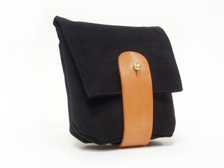 """Waxed Canvas Hip Pouch designed and manufactured by Death and Texas. """"One of our favorite local brands. Grace Teng makes all of her products by hand right here in Williamsburg."""" Available at Brook Farm General Store."""