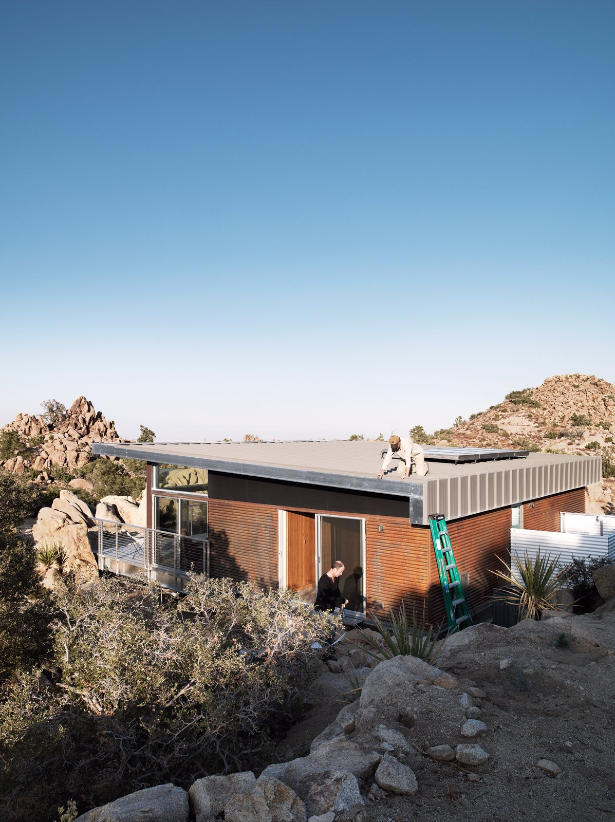 "As a paean to the old steel-mining shacks that inspired the home, McAdam sprayed the the corrugated-steel exterior with apple cider vinegar to create a warm rust effect.  Photo 9 of 10 in Small ""Hybrid Prefab"" Home in the Desert"