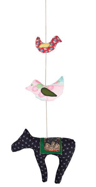A textile mobile from Hillery Sproatt.