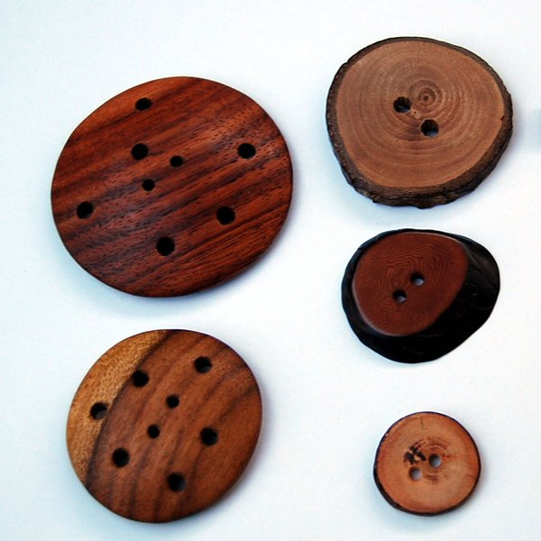 Wooden Button SetWe personally chose each and every button for our exclusive button set. Each button is hand crafted from environmentally friendly wood. The perfect addition to any scarf or sweater. They're just so pretty!