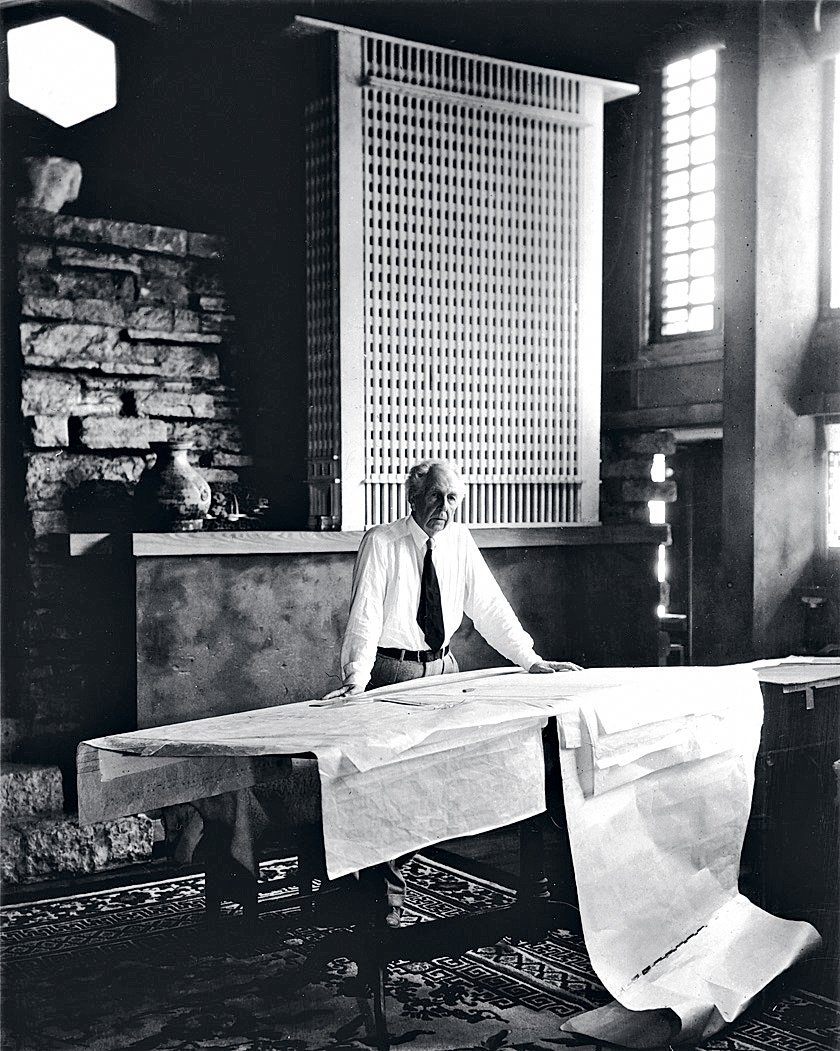 """""""When I set up this shot of Wright in his studio at Taliesin, he hadn't shaved that morning and told me he wasn't about to. So I had to move the camera back to conceal the stubble, which actually improved the shot."""" Behind Wright is a model of the San Francisco Call building, a favorite of his that was never built.  Pedro E. Guerrero by Christene Barberich"""