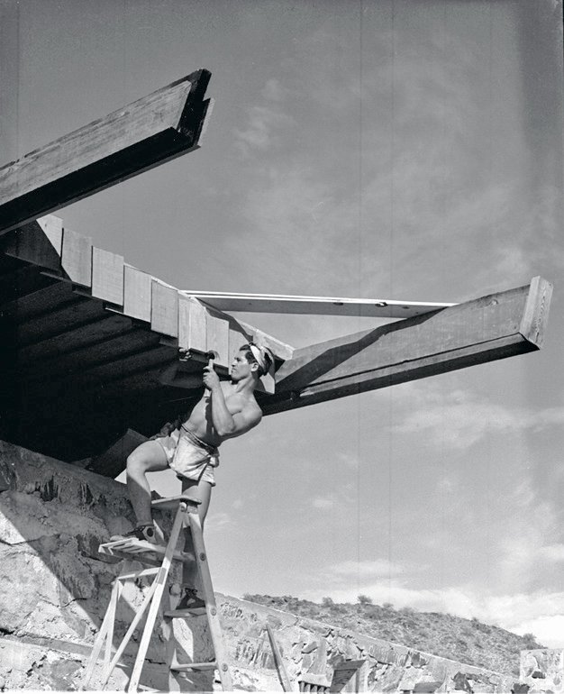 "Alfie Bush was one of the many young apprentices who helped build ""the Camp,"" as Taliesin West was then called. Here he's shown working on the dining hall.  Pedro E. Guerrero by Christene Barberich"