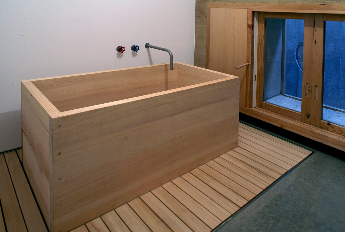 "Bath Room and Freestanding Tub The bathtub is a simple box made of fragrant hinoki cypress. Its shape echoes one of Cho's favorite inspirations: a wooden apple crate.  Search ""byoung cho"" from Underground House in Seoul"