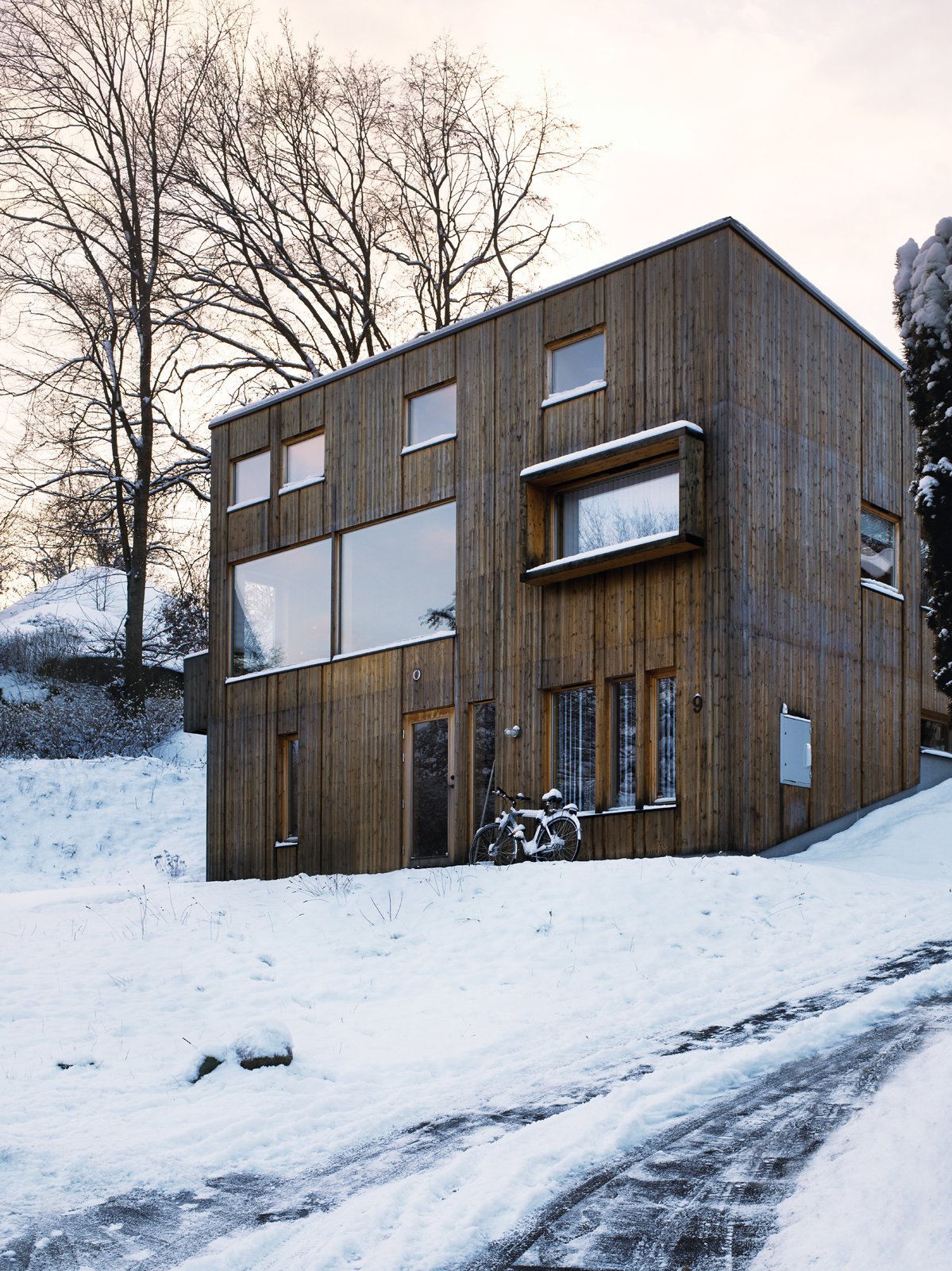 Exterior, Cabin Building Type, Wood Siding Material, and Shed RoofLine The facade is punctured by a variety of differently sized windows: Those flush to the wall indicate the house's public rooms, while the those for the private spaces are set back.  Photos from Knotty by Nature