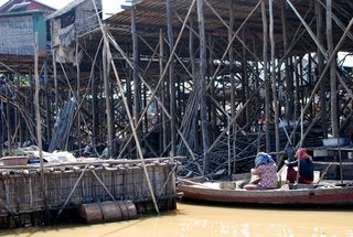 I was lucky enough to be visiting during the dry season, when water levels in the lake are lower and all of the stilted structures below the living areas are revealed.  Many families use the lower areas for storage during the dry season, putting aside fishing nets and cookingware, or hanging clothes to dry.