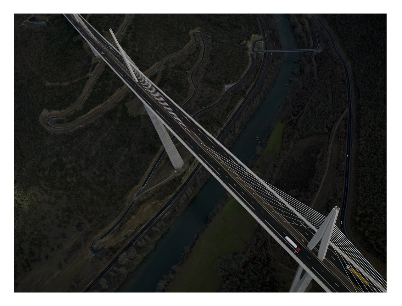The Millau Viaduct is a cable-stayed road bridge in southern France. It's the tallest vehicular bridge in the world (taller than the Eiffel Tower) and was designed by architect Norman Foster and structural engineer Michel Virlogeux.  Überblick by Thomas Heinser by Aaron Britt