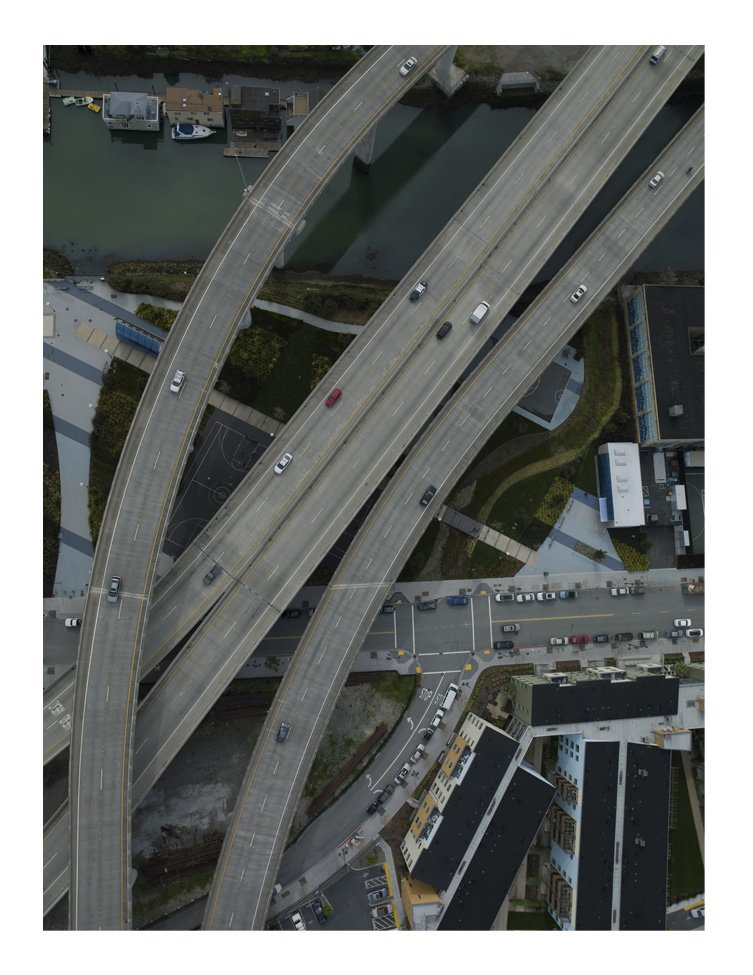 This photo is called 3rd and 6th and graphically describes a variety of forms of transits, the freeway superimposed over the waterway.  Überblick by Thomas Heinser by Aaron Britt