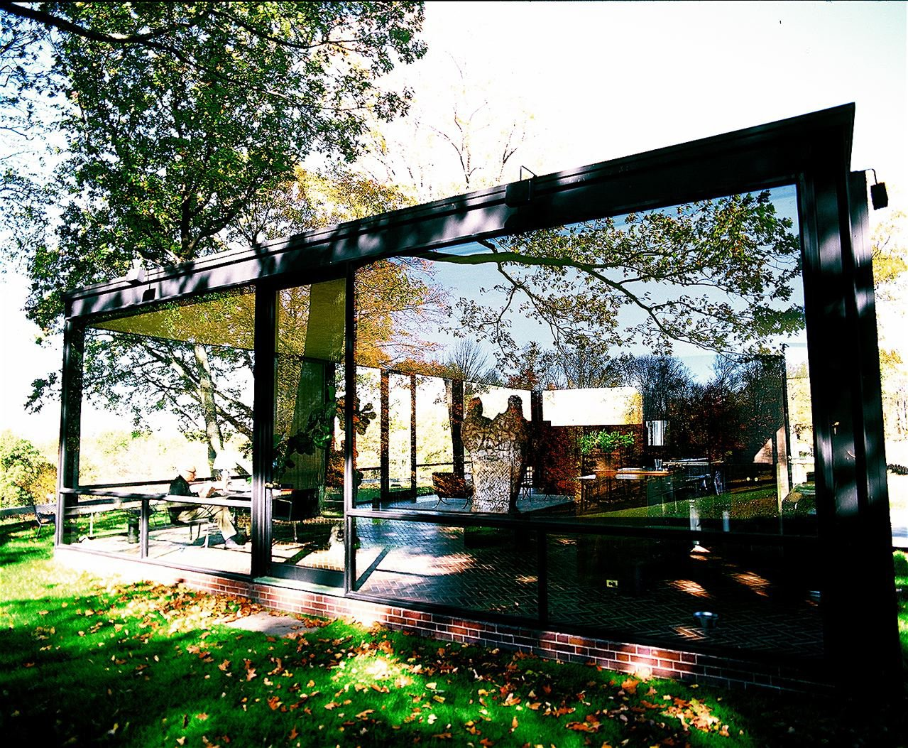 Philip Johnson in his Glass House. Philip was the first recipient of the Pritzker Prize award. I think it is the only photograph in which you see Philip in the house and the house in its entirety.  Richard Schulman's Photographs by Bradford Shellhammer from Richard Schulman