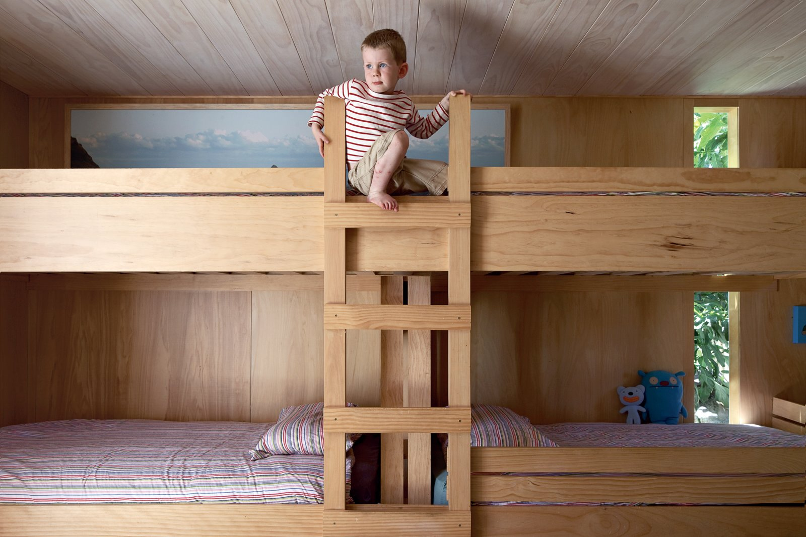 Kids Room, Bedroom Room Type, and Bunks In the kids' room, Seamus climbs the bunk beds he shares with his siblings.  Photo 10 of 11 in The Great Compression