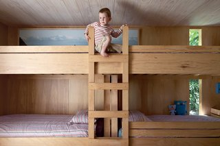 In the kids' room, Seamus climbs the bunk beds he shares with his siblings.