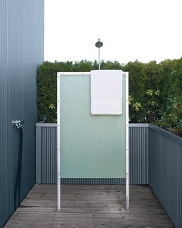 The home's exterior fittings, like the outdoor shower, offer modern comforts.