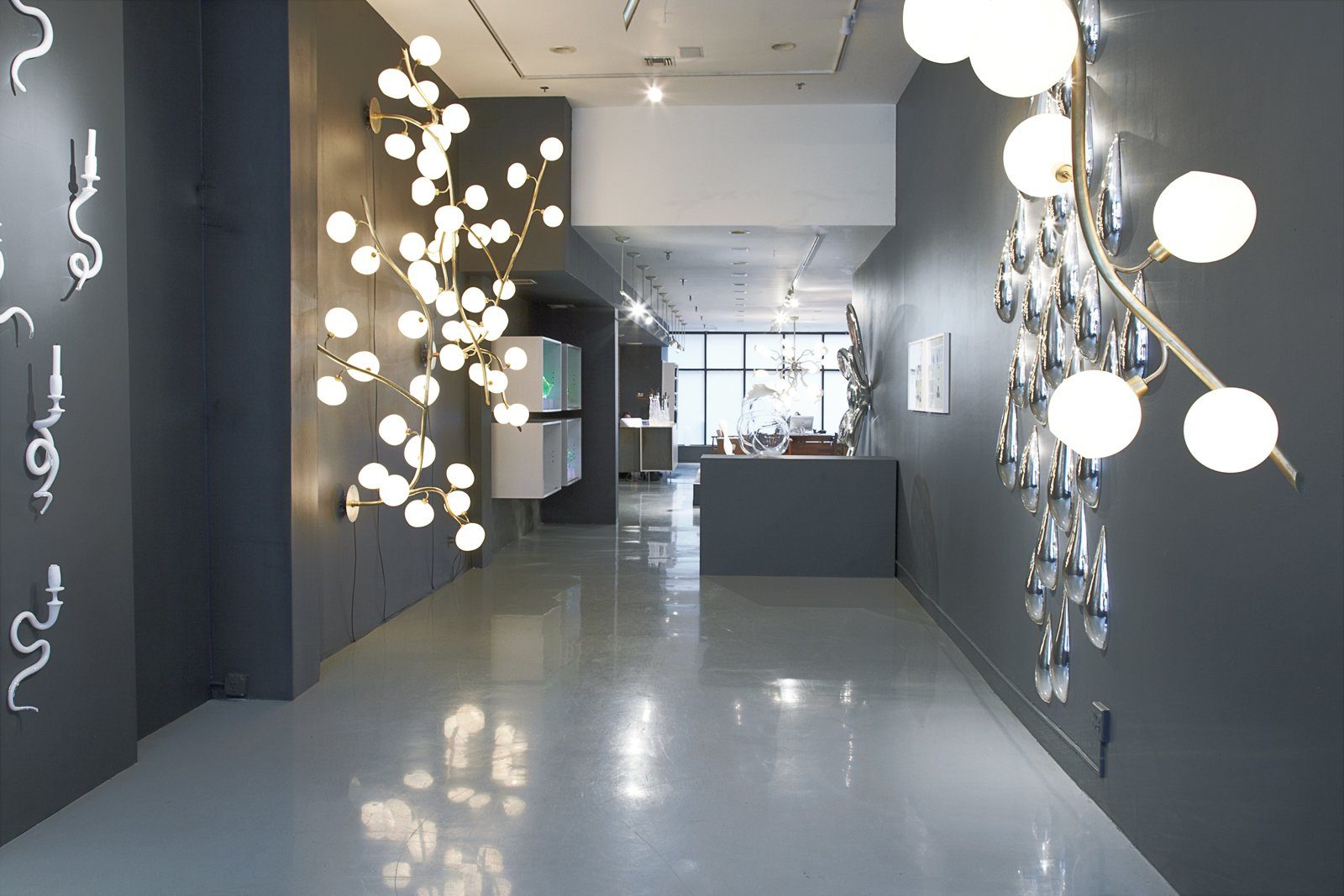 The Drawing With Glass exhibit featured handblown sculptures and illuminated fixtures inspired by nature and brought to life in organic shapes.  Revival of the Fittest by Jordan Kushins