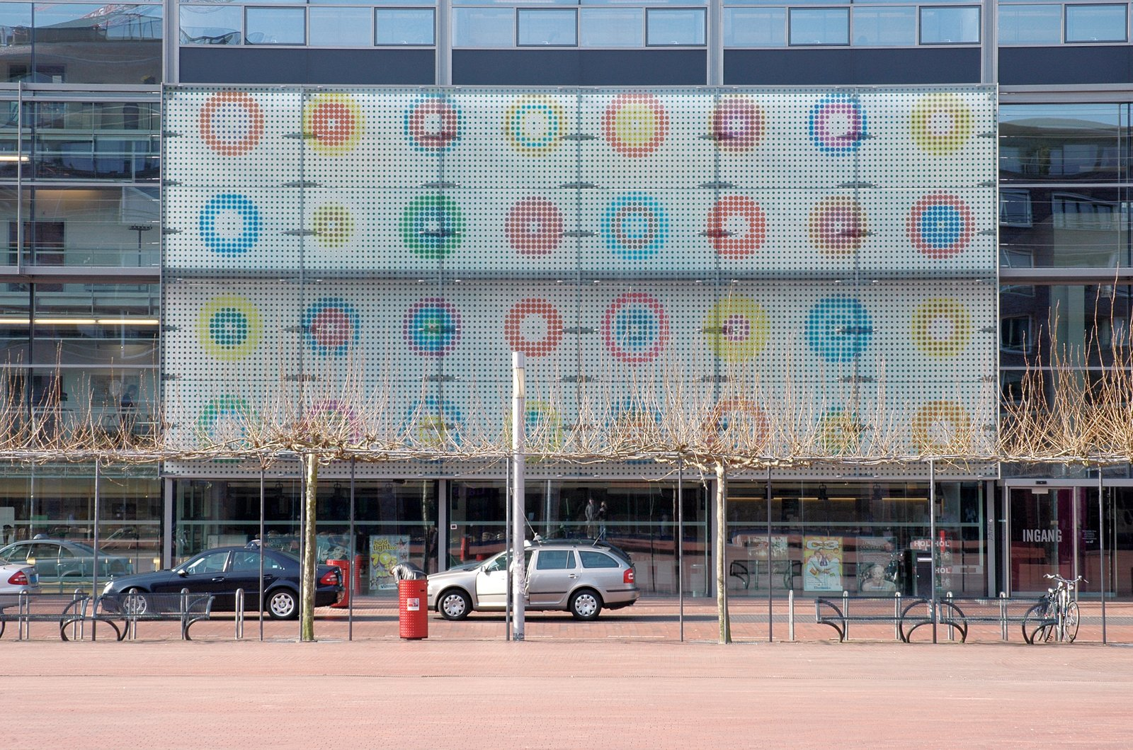 Martens's iconic targets punctuating the exterior panel of the Amstelveen Cultural Center.  Photo 6 of 18 in Dutch Master