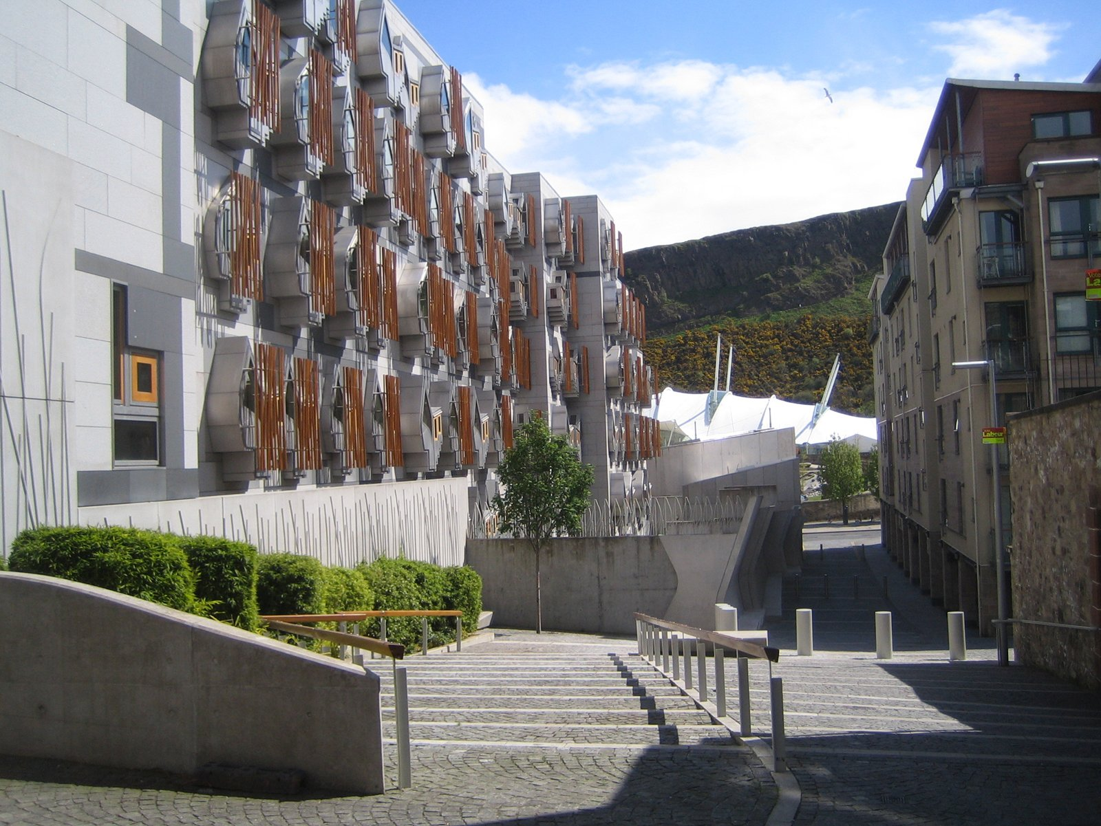 From Reid Close I got a great view of the back of the Scottish Parliament building and the craggy Arthur's Seat. The MPs's Thinkpods can be seen on the exterior of the Parliament.  Photo 6 of 11 in Scotland: Day 2