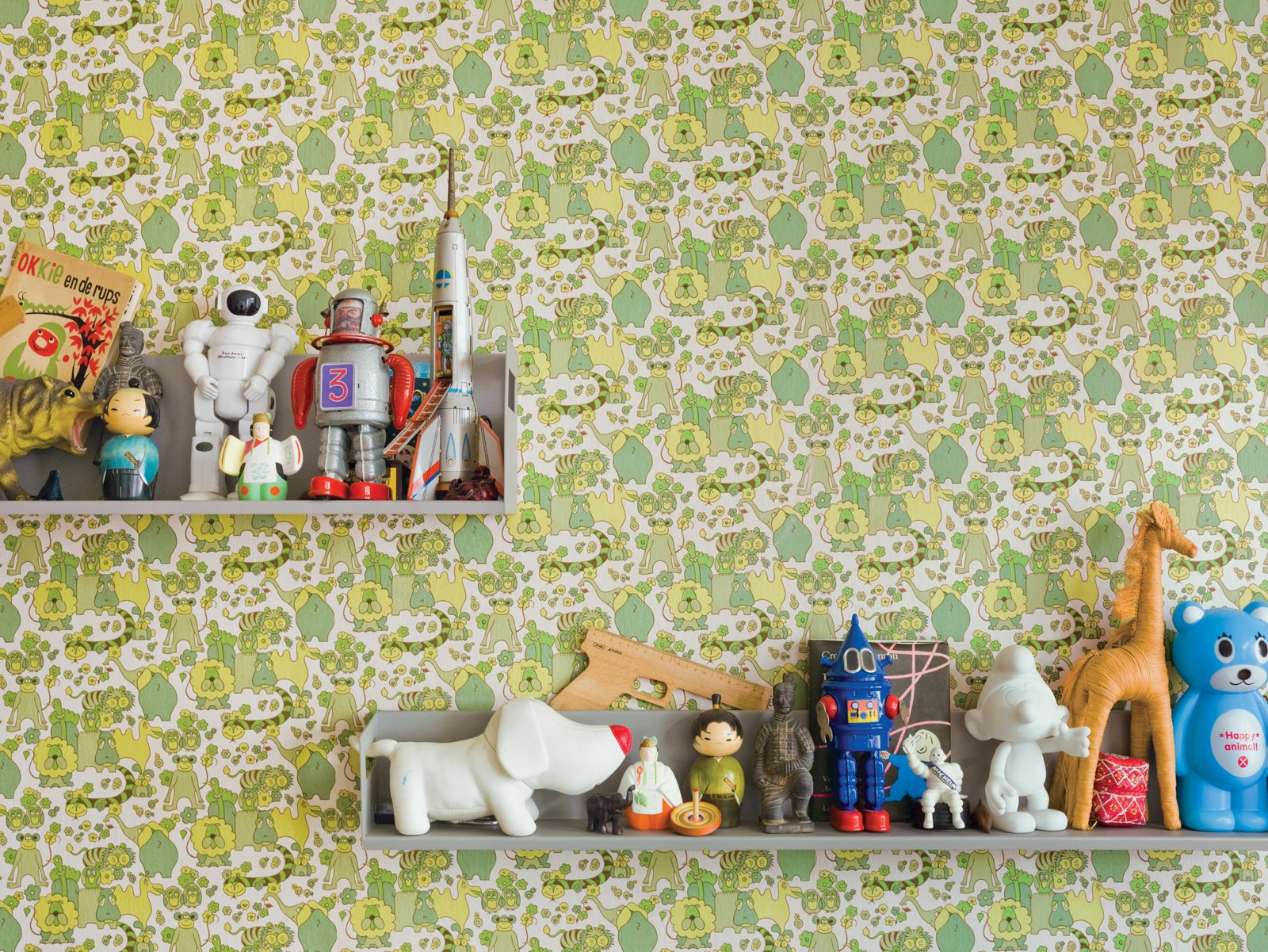 "Because their home is a rental, De Waart was limited in the changes she could make. In the boys' room, she added vintage wallpaper. ""From a distance it appears to be all shades of green but when you have a closer look, it turns out to be one big jungle,"" De Waart says. She covered just a single wall with the paper to keep the room from feeling overrun with color.  Photo 24 of 42 in Wallpaper That Fixes Walls"