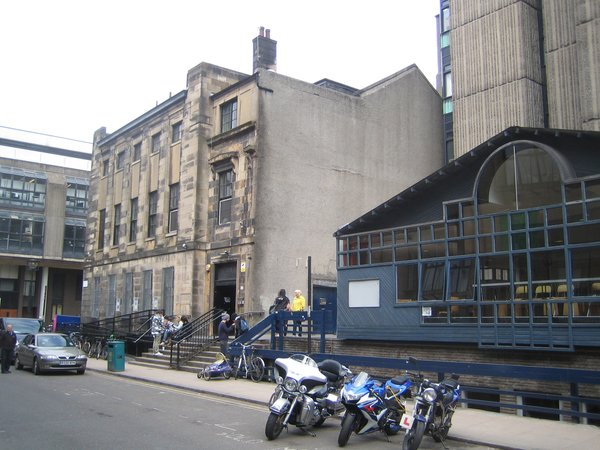 Here are three buildings (with that brutalist tower glimpsed in back) that are to go in favor of the new Steven Holl building. The Victorian building at the end of the block is home to the Vic, a rather grungy student union and music venue that has birthed a number of Glasgow bands like Franz Ferdinand.