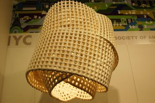 It took several years for Brooklyn designer Scott Strickstein to perfect the process of creating his ceramic light fixtures, called C Mesh. This one weighs about forty lbs.