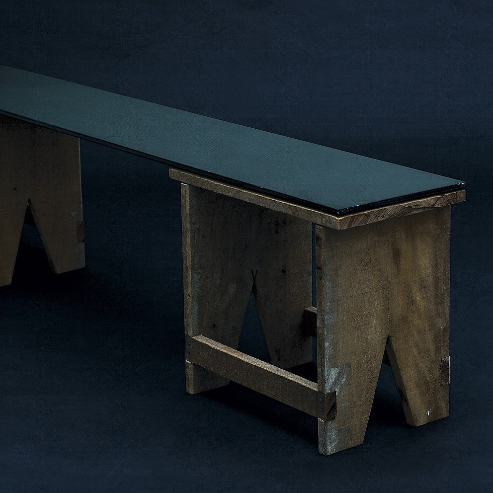A carbon fiber plate joins the two benches that make up the Banco Chamego.  Prostheses and Grafts by Aaron Britt