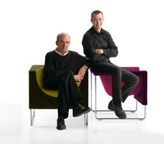 Jon Gasca, right, and his father, Jesús, pose with the two-toned Nube chair, which won a Good Design Award in 1998.