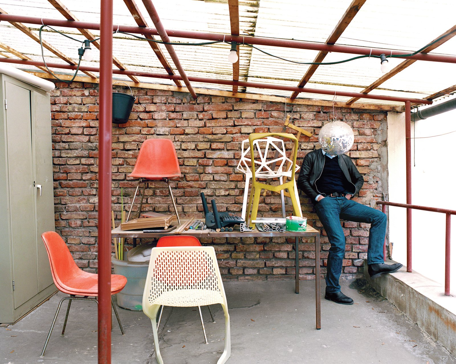 """The """"terrace"""", in his unassuming former factory space not far from the main train station in Munich, is a place where he and his cohorts can step outside for a breath of fresh air. A handful of classics as well as his own chairs—–like the Myto (foreground) and the Chair One (on the table at right)—–upstage the suddenly bashful designer.  Photo 3 of 26 in Industrial Designer Focus: Konstantin Grcic"""