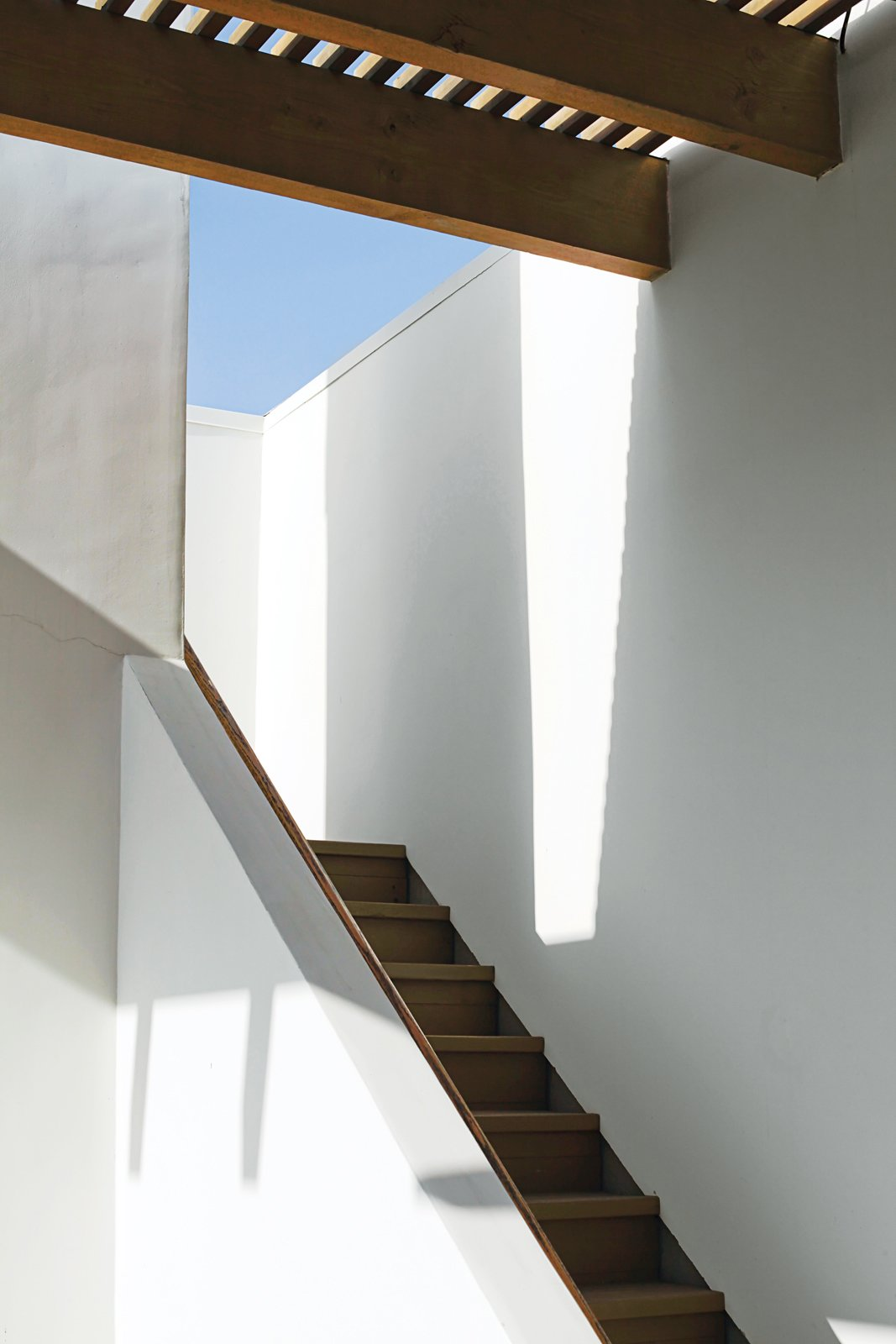 Staircase and Wood Tread Sunlight and shadows accentuate the architectural forms around the stairway leading to the roof deck.  Photo 6 of 13 in Coast Docs