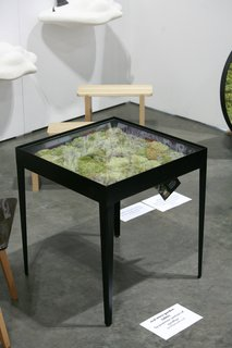 A trio of Real Moss Garden Tables by Pawinee Santisiri of Ayodhya enlivens the Thai booth of Asia Now. A handsome and verdant addition to any space.