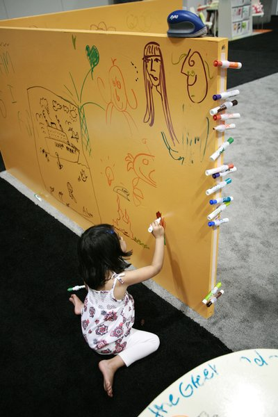 Go ahead, let them write all over the walls: One coat of the water-based IdeaPaint turns an entire child's room into a huge dry-erase board compatible with AP non-toxic pens. Specifically for the show, the company rolled a layer onto a playhouse that nearly every child at the conference tagged; it will be erased clean and donated to Habitat for Humanity.