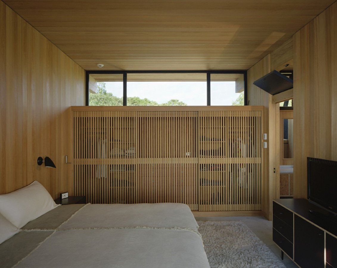 Bedroom and Bed Before he built the home, Cary climbed up ladders to ensure that each bedroom would be within earshot of the sound of the waves. Courtesy Architects and Artisans.  Shelter Island Retreat by J. Michael Welton